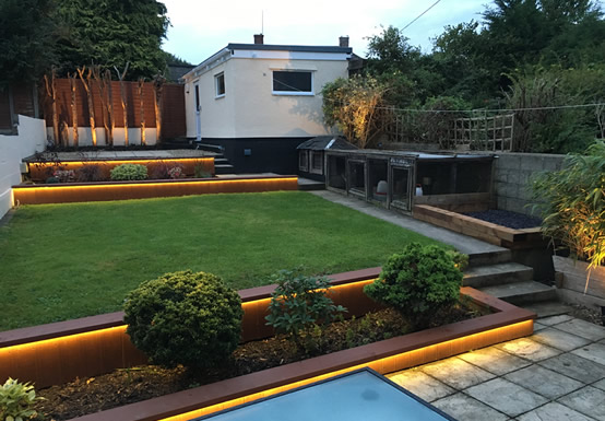 Garden lighting with LED strip around the borders and spot lights to highlight trees